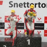 Dg On Podium With Champagne